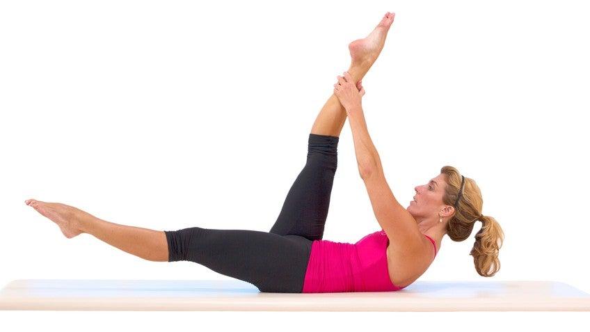 Single Leg Stretch Pilates Mat Exercise foto