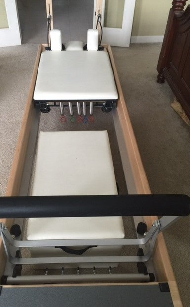 I also have an adobe white matching wunda chair for sale for $1000. It is the combo split pedal chair and comes with the removable handles. & Forums | General Discussion | looking for a balanced body reformer used
